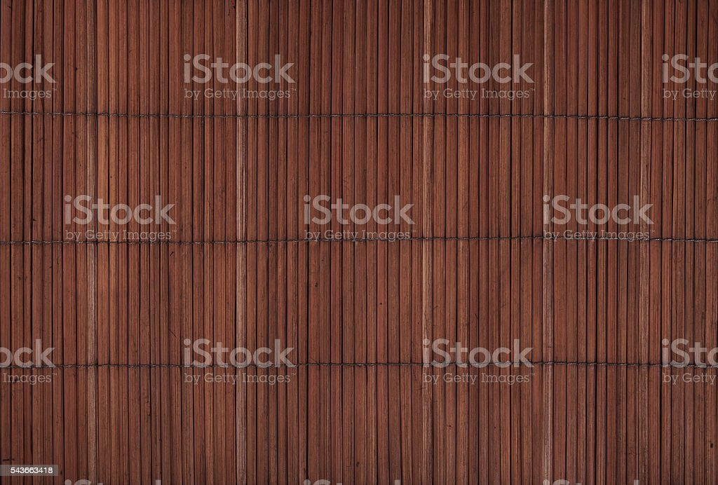 Vintage brown bamboo wood mat background texture stock photo
