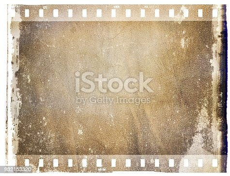istock Vintage brown film strip frame with leather surface. 932153320
