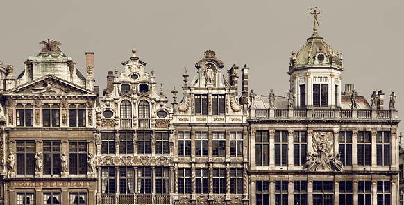 Vintage brown filter on historical buildings located in Grand Place of Brussels, Belgium.