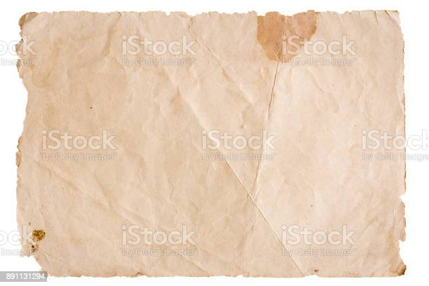 Photo of vintage brown paper isolated on white background