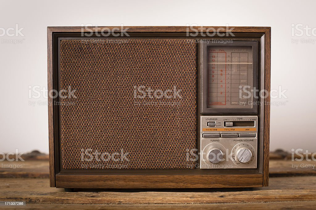 Vintage Brown Radio Sitting on Wood Table stock photo