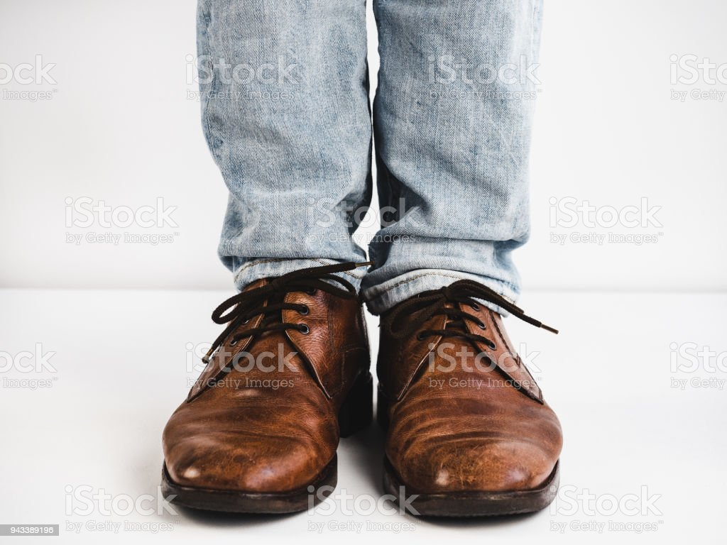 Vintage, brown shoes, jeans and man's feet - Stock image .