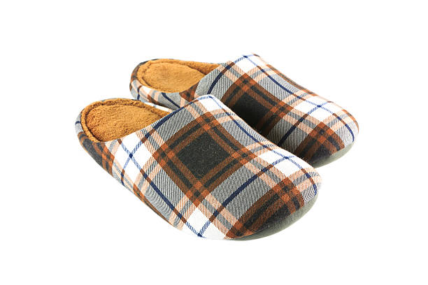 Vintage brown slippers stock photo