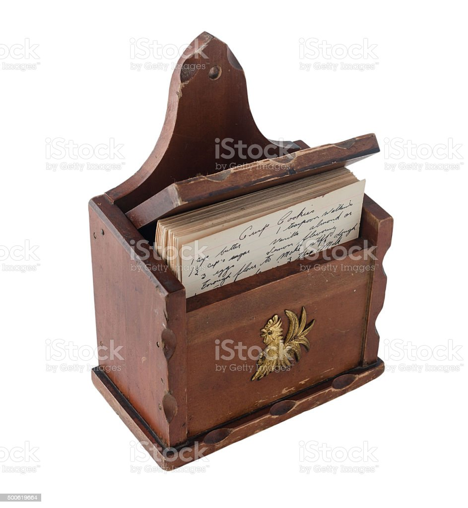 vintage brown wooden recipe box with handwritten recipes inside stock photo
