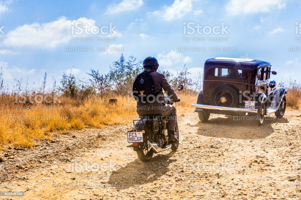 Vintage Buick followed by motorcycle at a show in Magaliesberg stock photo