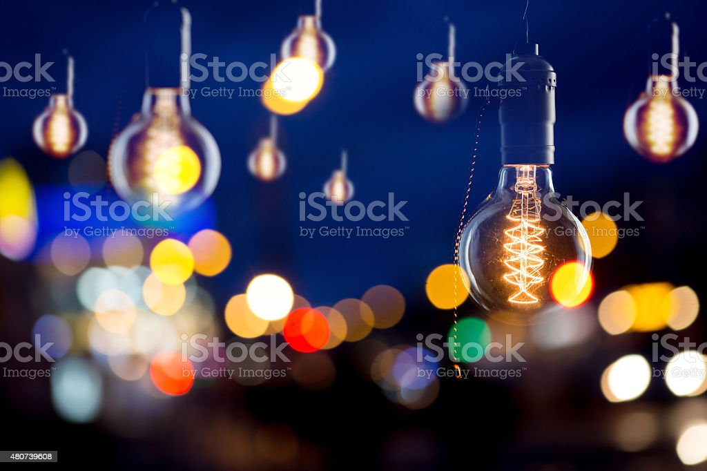 Vintage bulbs and city reflections in window stock photo