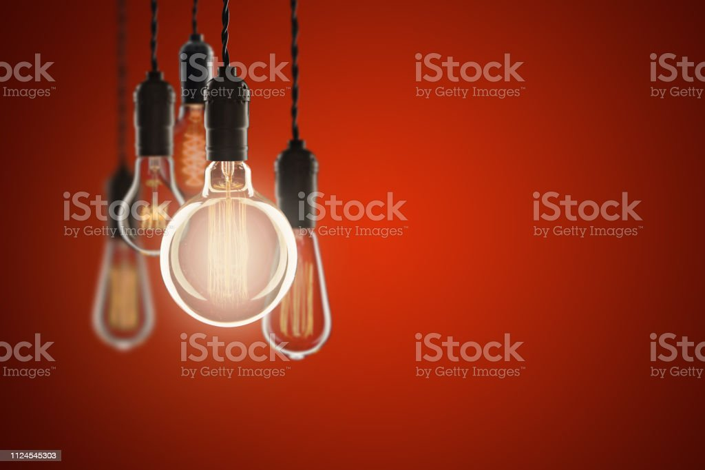 Vintage bulbs on color background - idea, innovation, teamwork and leadership concept. Space for text stock photo