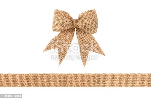 Vintage burlap ribbon bow for gift decoration isolated on white background