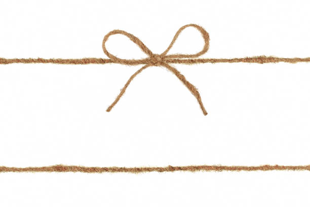 vintage burlap rope bow isolated on white background - string stock photos and pictures