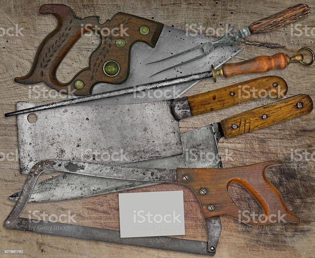 vintage butcher shop set over wooden table stock photo