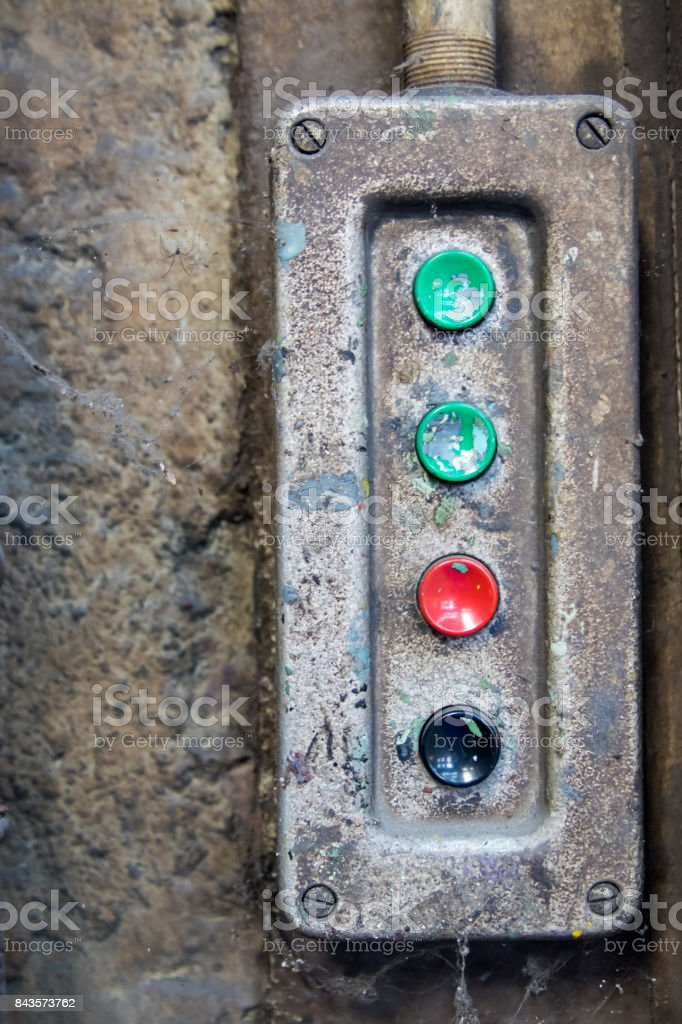 Vintage buttons on a device in an industrial area stock photo