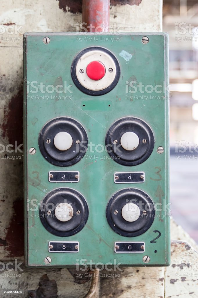 Vintage buttons on a green plate in an industrial area stock photo