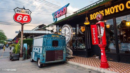 Bangkok, Thailand - July 21, 2019: vintage items (a van, old gas stations' equipment, a retro clock, etc) at Rod's Moto Cafe at Train Night Market at Srinakarin (Talad Rot Fai Srinakarin).