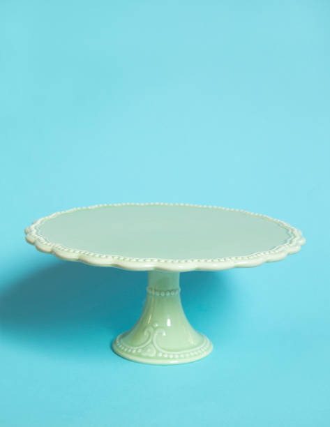 Vintage cake stand Vintage cake stand on blue background cakestand stock pictures, royalty-free photos & images