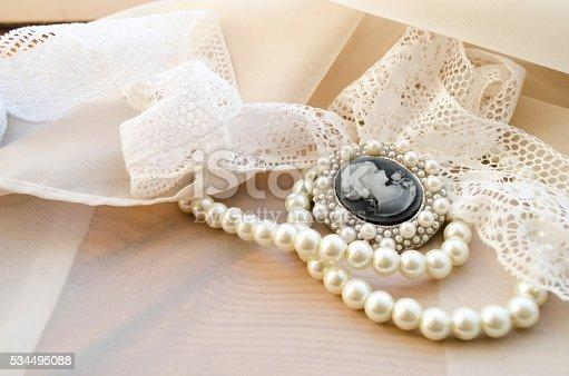 istock vintage cameo, pearls and lace 534495088