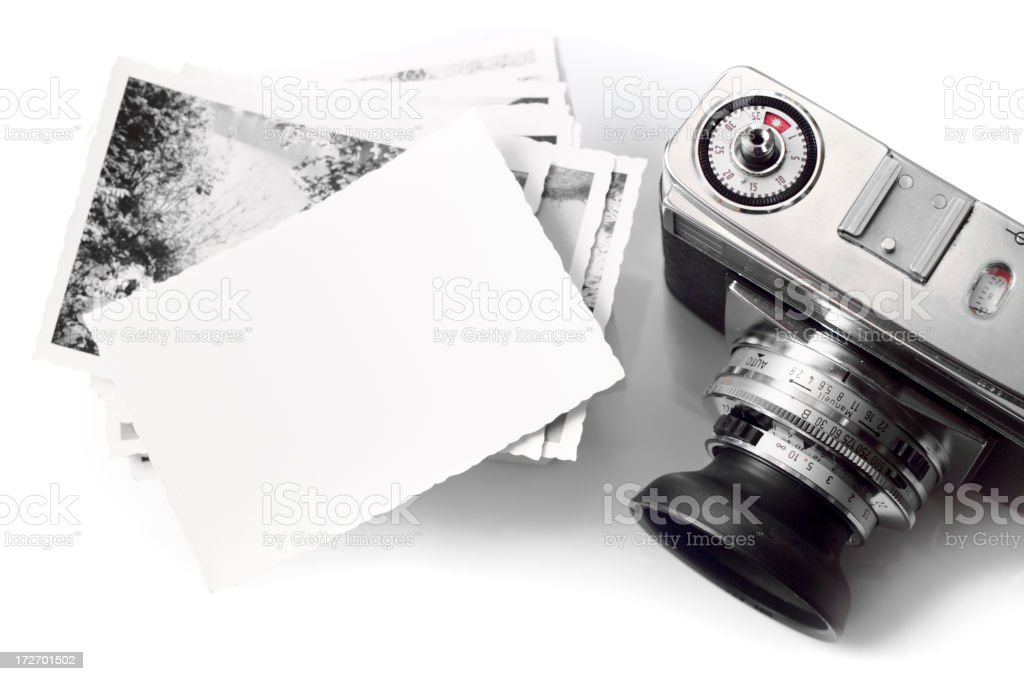 Vintage Camera & Blank Photopaper Vintage Camera & Blank Photopaper Above Stock Photo