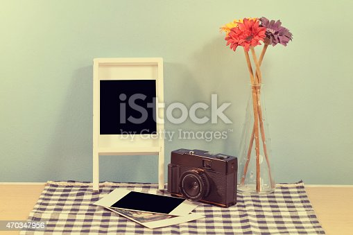 609706398 istock photo vintage camera and album with old photos on table. 470347956