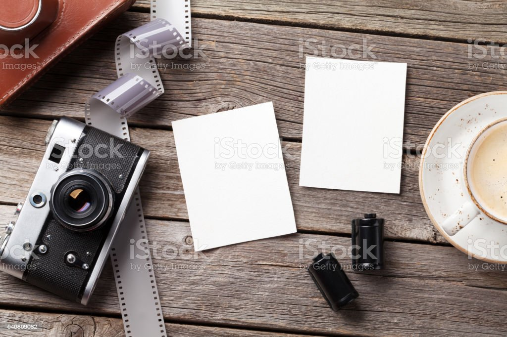 Vintage camera and blank photo frames stock photo