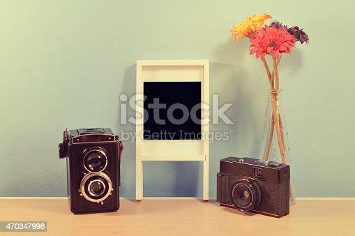 609706398 istock photo vintage camera and Frame photos. 470347998