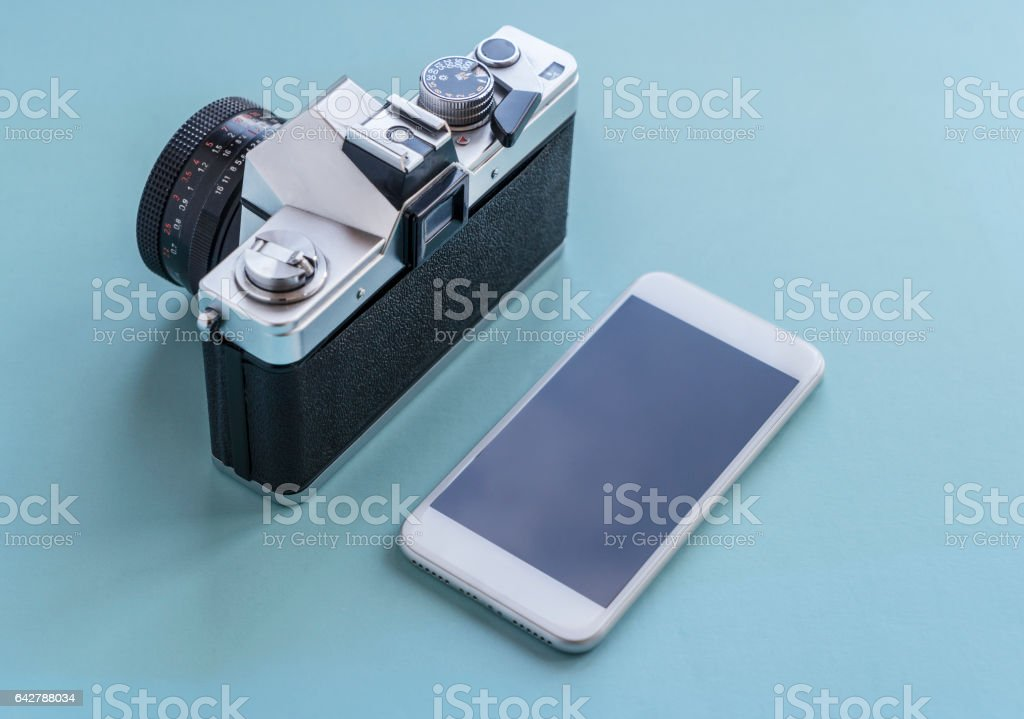 Vintage Camera And Modern Mobile Phone stock photo