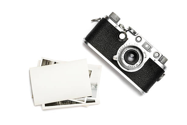 Vintage camera and old photos. View from the above. stock photo