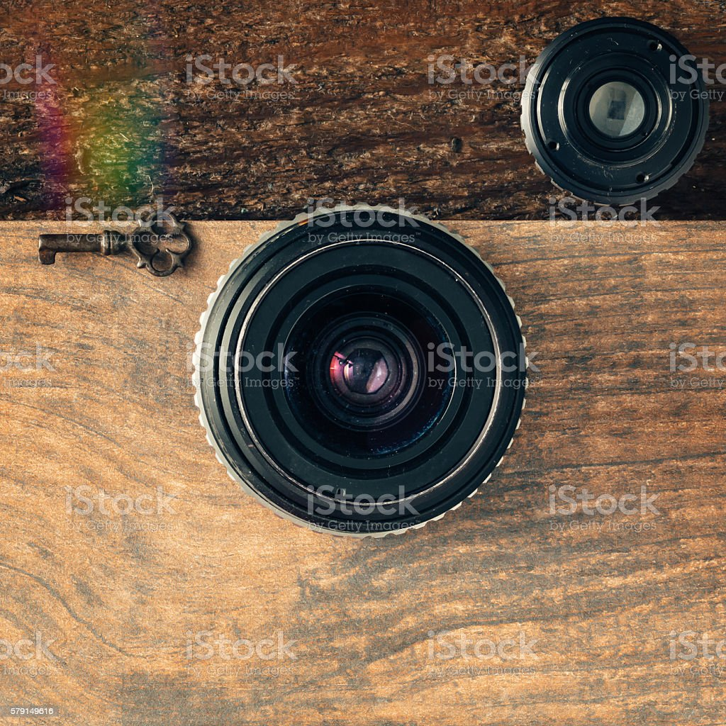 Vintage camera gear on wooden background stock photo