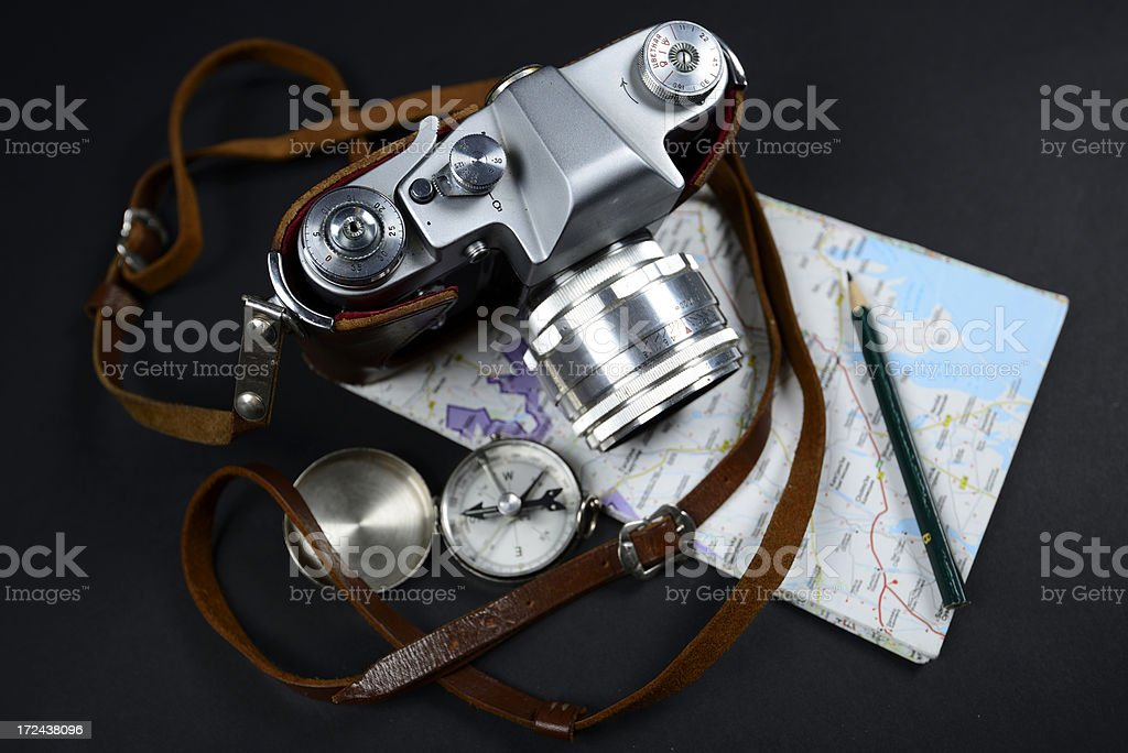 Vintage camera, map and compass on black background royalty-free stock photo