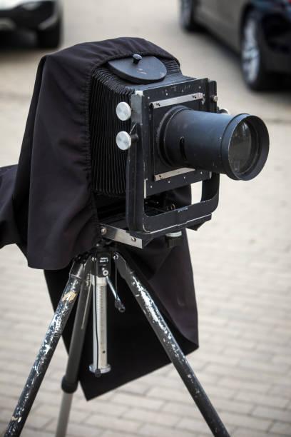 Vintage camera on a tripod stock photo