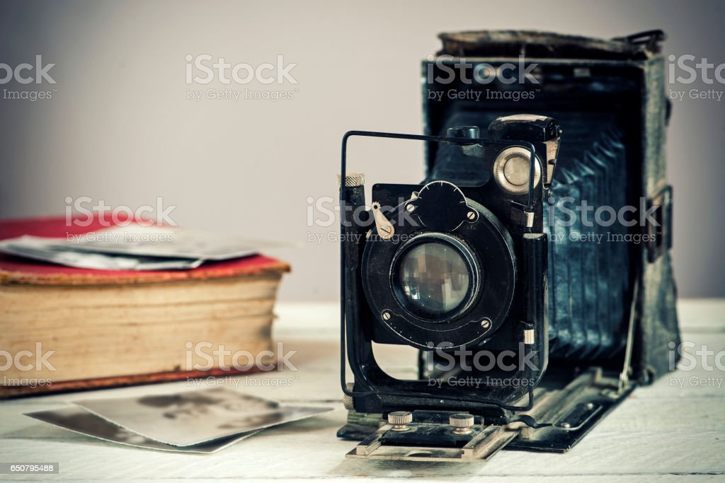 Vintage camera on a wooden background