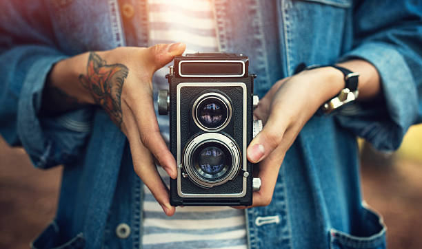vintage camera photographer focus shooting concept - styles stock photos and pictures