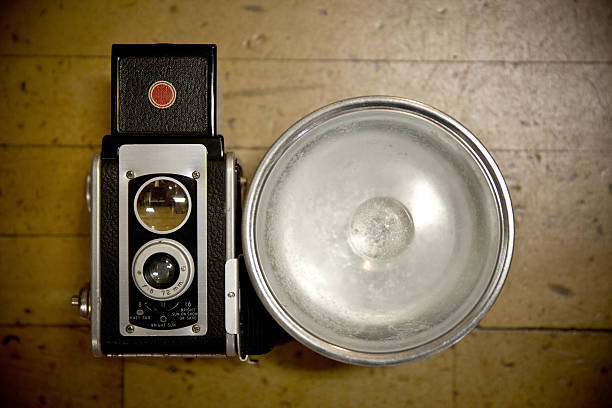 Vintage Camera Vintage camera with large flash, close up anachronistic stock pictures, royalty-free photos & images