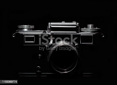 vintage camera silhouette in the dark