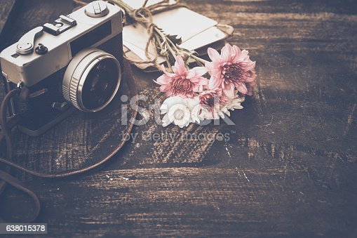istock Vintage camera with bouquet of flowers 638015378