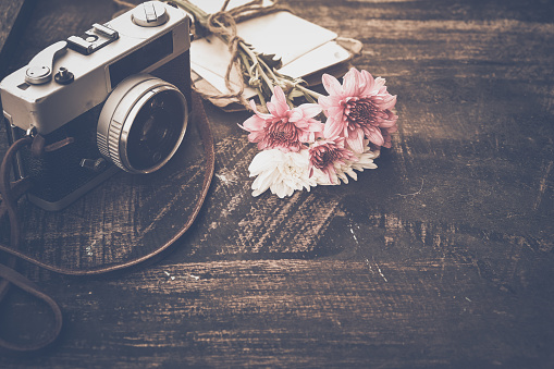 Vintage camera with bouquet of flowers
