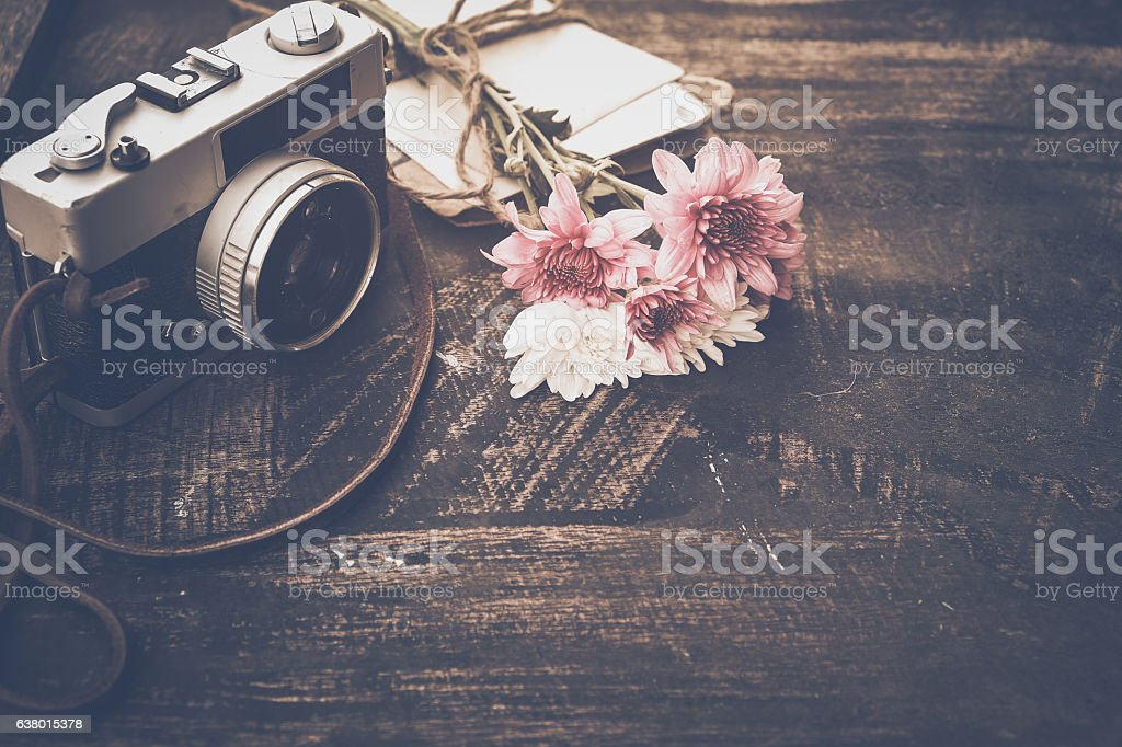 Vintage camera with bouquet of flowers - Photo