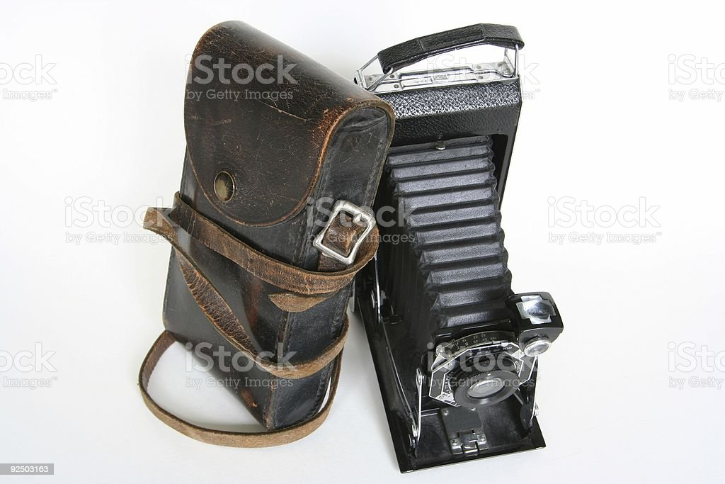 Vintage Camera with Leaning Leather Case royalty-free stock photo