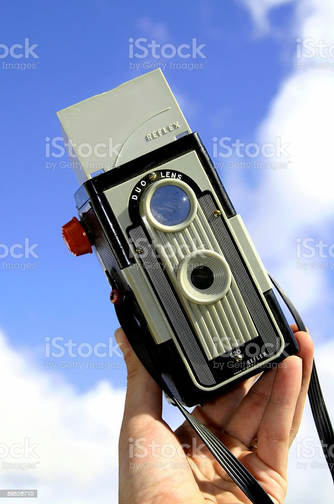 Vintage Camera with Sky Background Verticle royalty-free stock photo