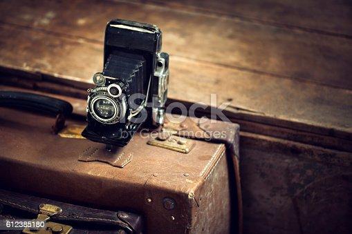 Vintage camera on old suitcase