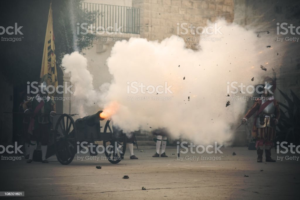 Vintage Canon Being Shot with Cloud of Smoke stock photo