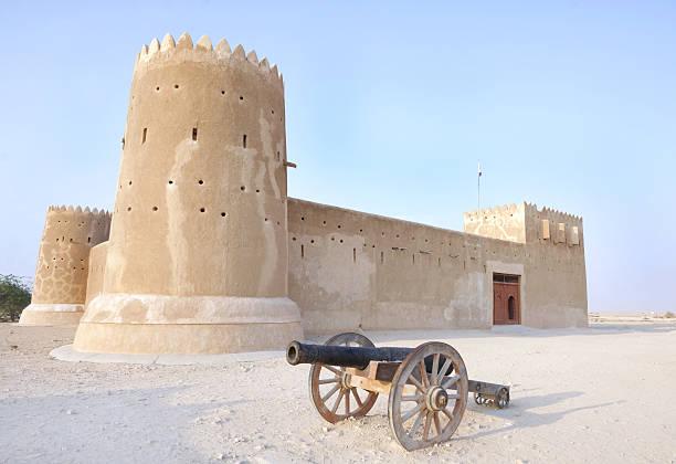 Vintage canon & Zubarah fort, Qatar stock photo