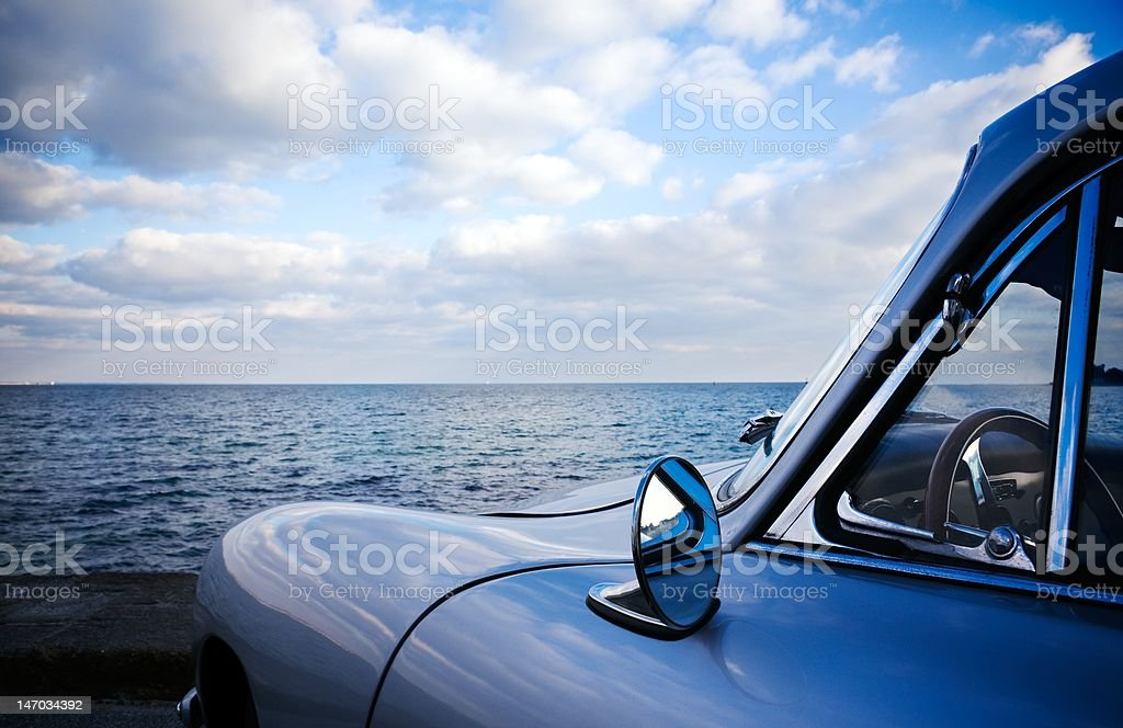 Vintage car close to the sea stock photo