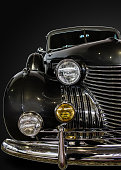 vintage car, close-up, dark background