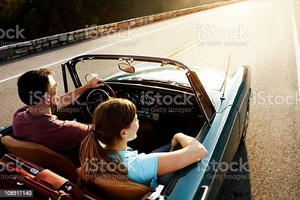 Vintage Car Couple Stock Photo - Download Image Now
