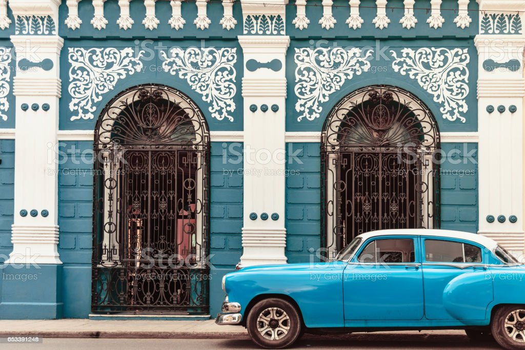 vintage car in front of colonial style house in Camagüey Cuba stock photo