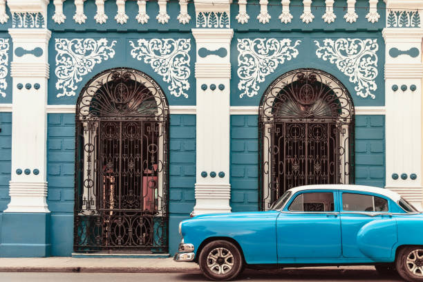 vintage car in front of colonial style house in camagüey cuba - cuba stock photos and pictures