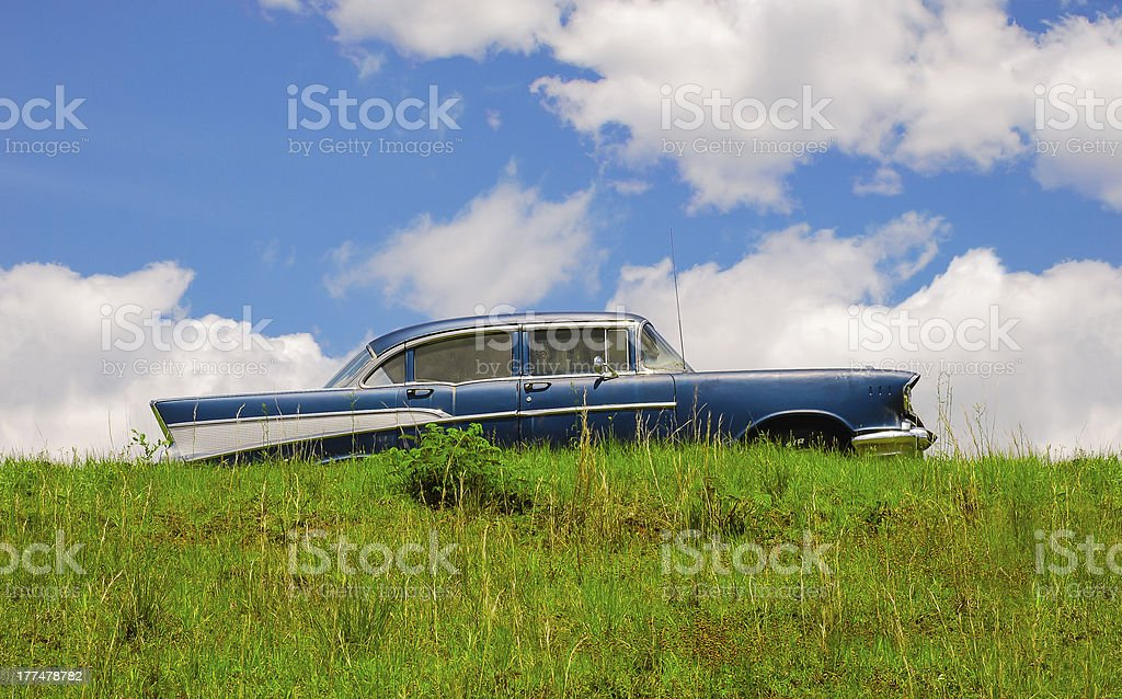 Vintage Car in Grassy Field royalty-free stock photo