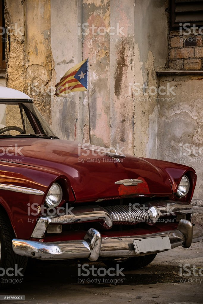 Front end of Vintage American made car parked on the street in old...