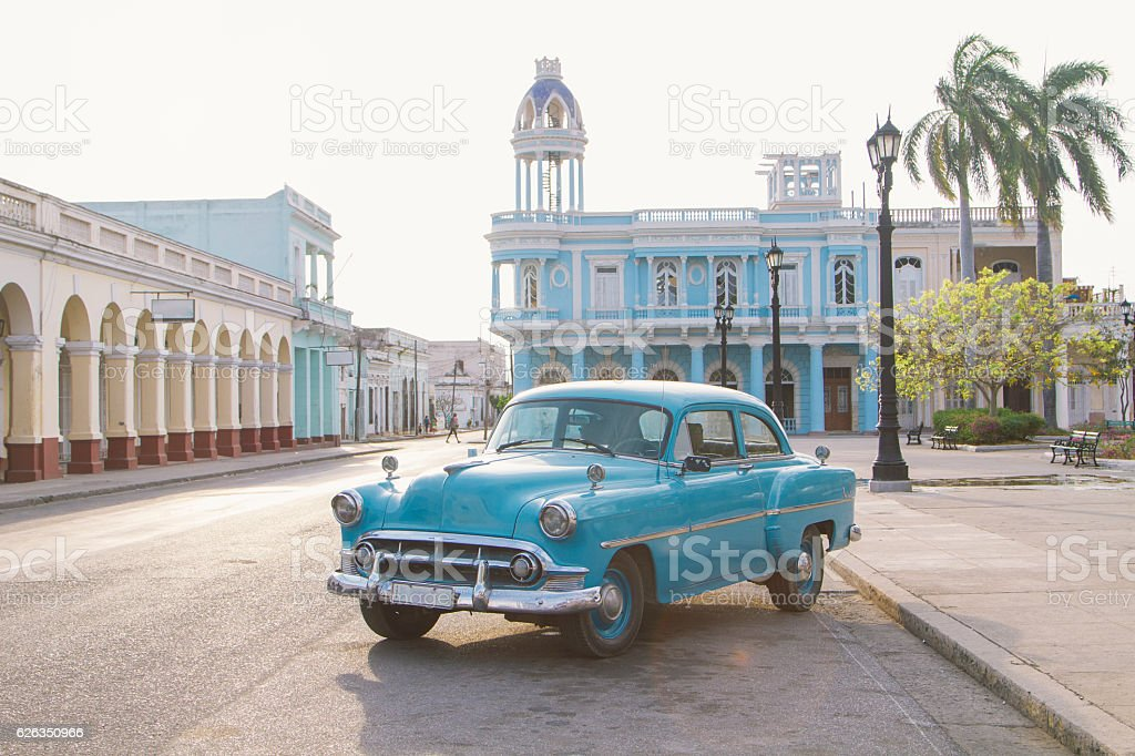 Vintage car in Jose Marti square, Cienfuegos, Cuba stock photo