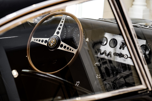 Parma, Italy, 14 April 2018 - The vintage car interior by the driver seat of a Jaguar E-Type