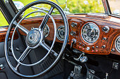 dashboard and steering wheel of a vintage convertible car